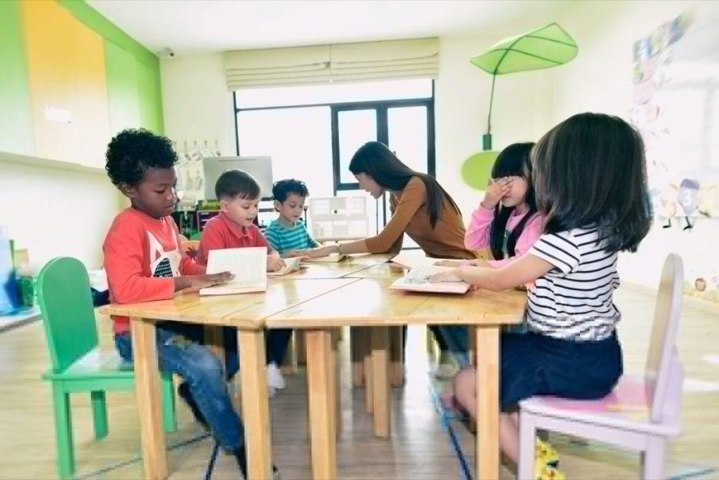 Children around a table in a child care center