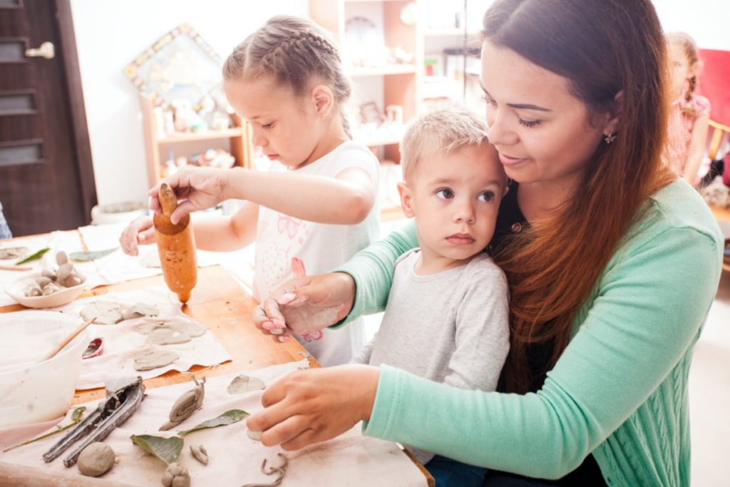 Staff helping children with crafts.