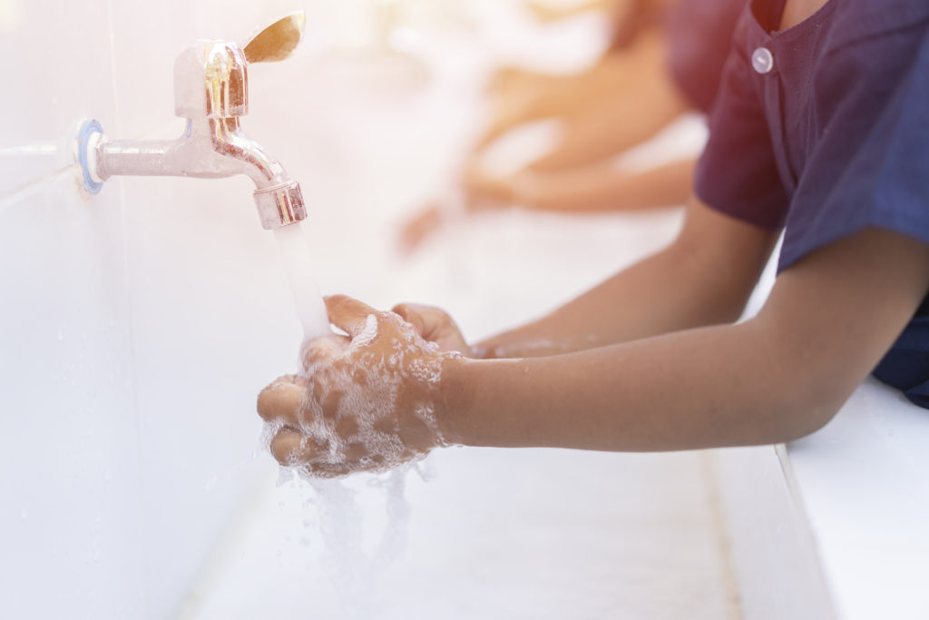 close-up-hands-of-children-or-pupils-at-preschool-washing-hands-with-soap-under-the-faucet-with-watercopy-space-for-text-or-product-you-clean-and-hygiene-concept