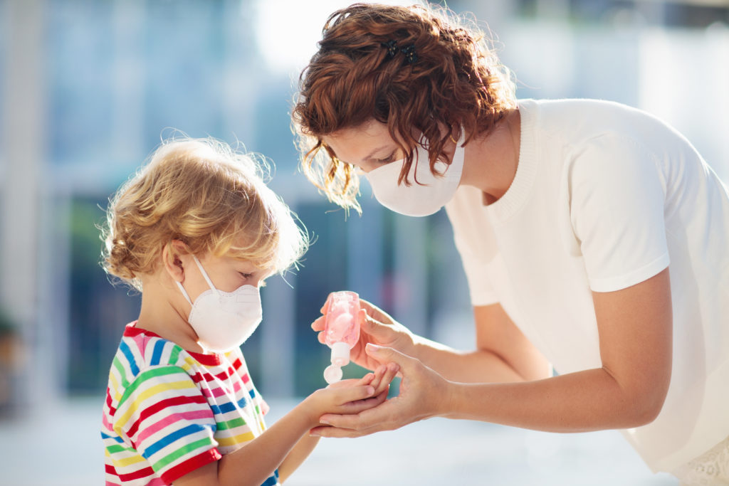 mother-and-child-with-face-mask-and-hand-sanitizer