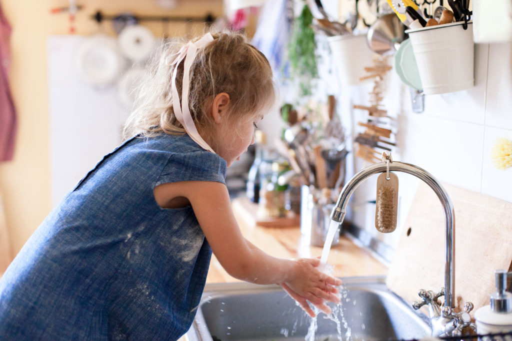 kid-washing-hands-at-home-under-water-tap-child-girl-in-flour-after-cooking-in-cozy-home-kitchen
